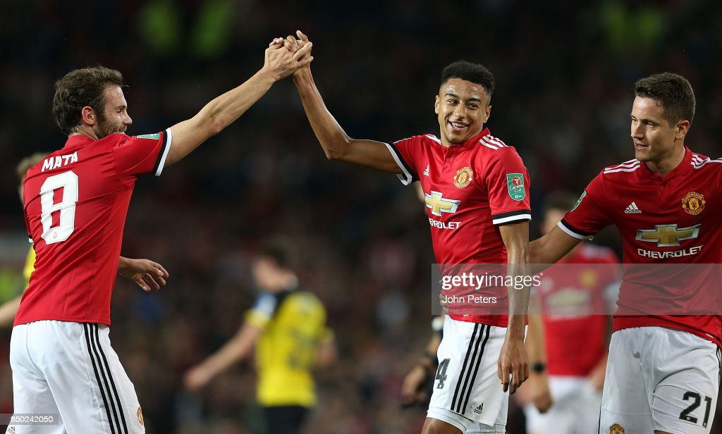 Jesse Lingard of Manchester United celebrates his part in Ben Turner of Burton Albion scoring an own goal during the Carabao Cup Third Round match between Manchester United and Burton Albion at Old Trafford on September 20, 2017 in Manchester, England.