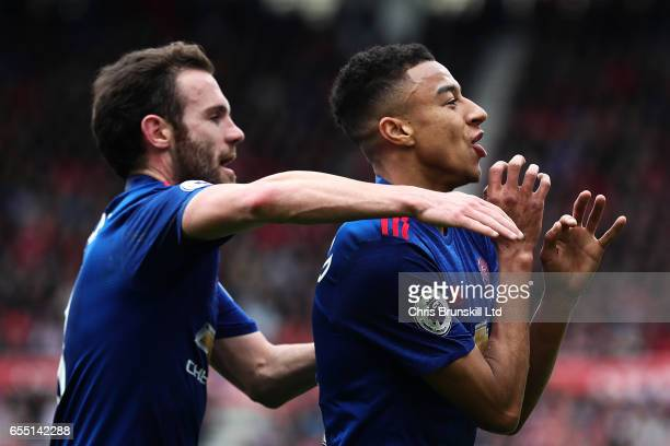 Jesse Lingard of Manchester United celebrates scoring his side's second goal with teammate Juan Mata during the Premier League match between...