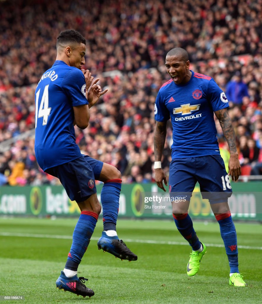 Jesse Lingard of Manchester United (L) celebrates scoring his sides second goal with Ashley Young of Manchester United (R) during the Premier League match between Middlesbrough and Manchester United at Riverside Stadium on March 19, 2017 in Middlesbrough, England.