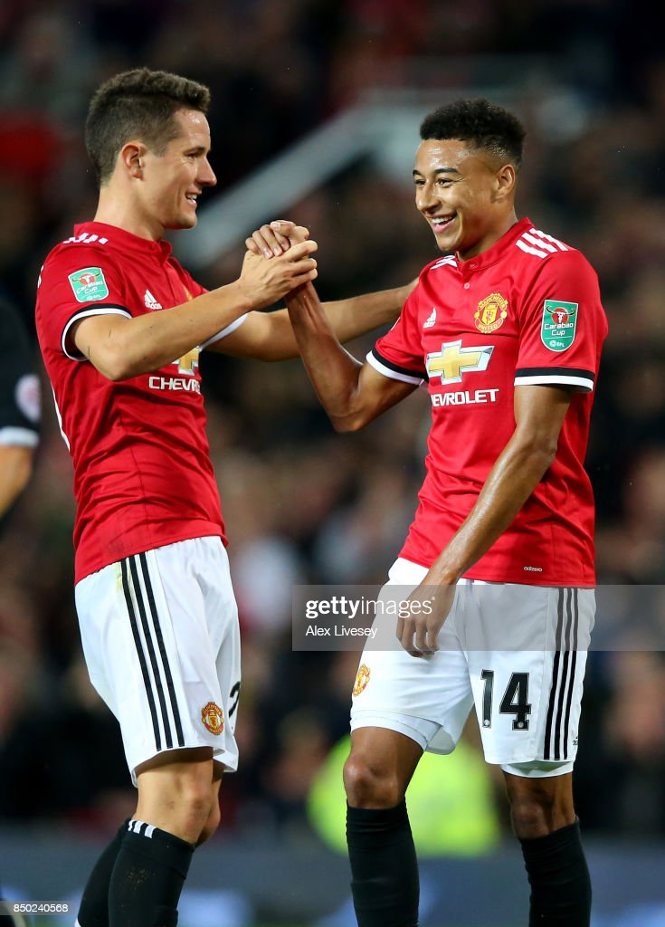 Jesse Lingard of Manchester United celebrates scoring his sides third goal with Ander Herrera of Manchester United during the Carabao Cup Third Round match between Manchester United and Burton Albion at Old Trafford on September 20, 2017 in Manchester, England.