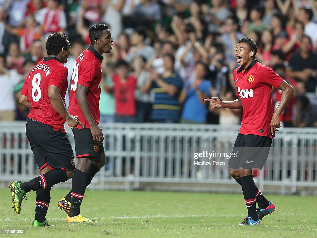 Jesse Lingard (R) of Manchester United celebrates scoring their fifth goal during the pre-season friendly match between Kitchee FC and Manchester United as part of their pre-season tour of Bangkok, Australia, Japan and Hong Kong at Hong Kong Stadium on July 29, 2013 in So Kon Po, Hong Kong.