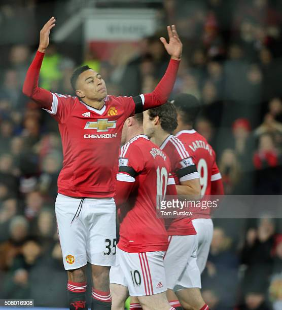 Jesse Lingard of Manchester United celebrates scoring their first goal during the Barclays Premier League match between Manchester United and Stoke...