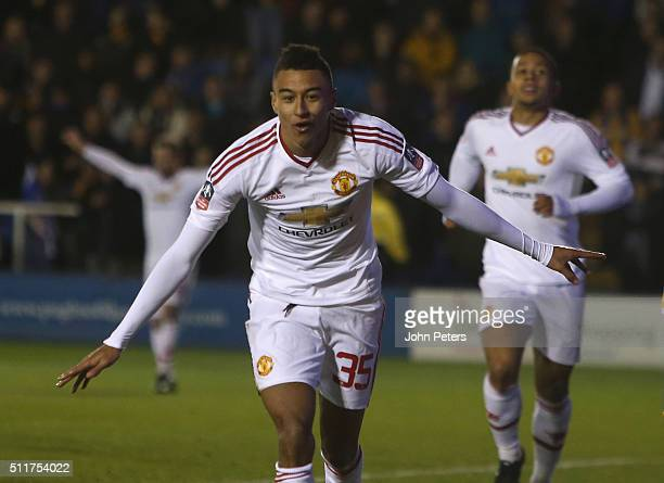 Jesse Lingard of Manchester United celebrates scoring their third goal during the Emirates FA Cup Fifth Round match between Shrewsbury Town and...