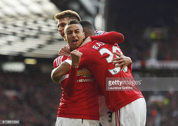 Jesse Lingard of Manchester United celebrates with goalscorer Marcus Rashford during the Barclays Premier League match between Manchester United and...