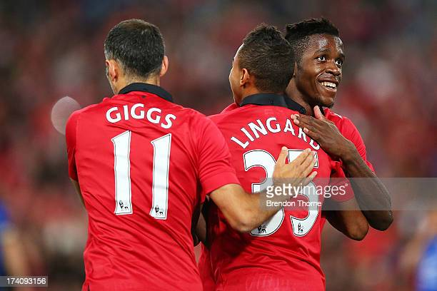 Jesse Lingard of Manchester United celebrates with team mates Ryan Giggs and Wilfried Zaha after scoring the opening goal during the match between...