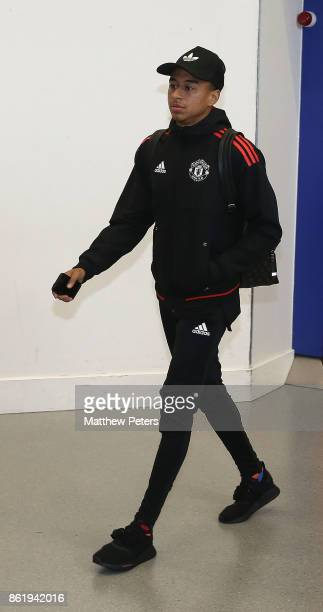Jesse Lingard of Manchester United checks in ahead of their flight to Lisbon for the UEFA Champions League match against Benfica at Manchester...