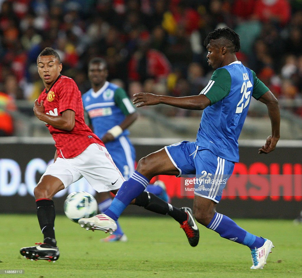 Jesse Lingard of Manchester United clashes with Bukasa Kasonga of AmaZulu FC during the pre-season friendly between AmaZulu FC and Manchester United at Moses Mabhida Stadium on July 18, 2012 in Durban, South Africa.