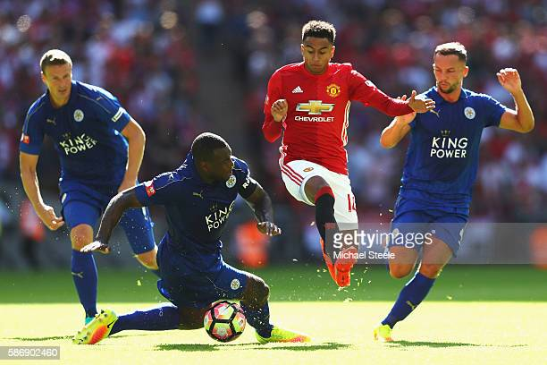 Jesse Lingard of Manchester United escapes a challenge from Wes Morgan of Leicester City during The FA Community Shield match between Leicester City...