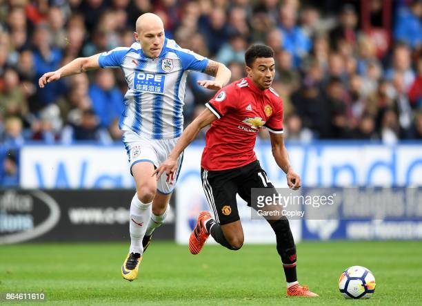 Jesse Lingard of Manchester United evades Aaron Mooy of Huddersfield Town during the Premier League match between Huddersfield Town and Manchester...