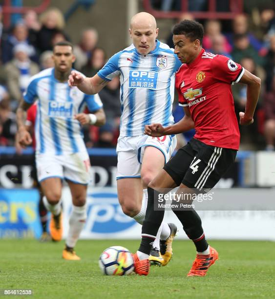 Jesse Lingard of Manchester United in action with Aaron Mooy of Huddersfield Town during the Premier League match between Huddersfield Town and...