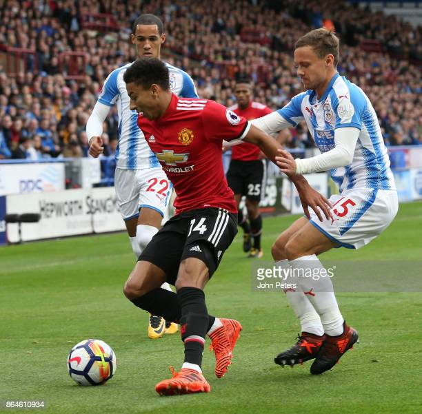 Jesse Lingard of Manchester United in action with Chris Lowe of Huddersfield Town during the Premier League match between Huddersfield Town and...