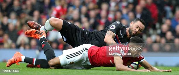 Jesse Lingard of Manchester United in action with Damien Delaney of Crystal Palace during the Premier League match between Manchester United and...