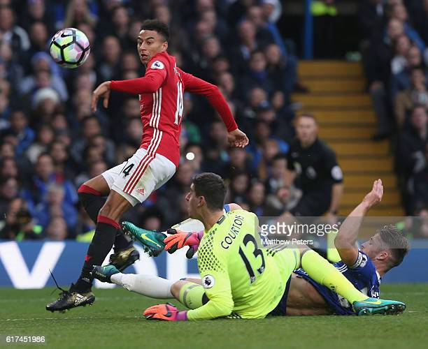Jesse Lingard of Manchester United in action with Gary Cahill and Thibaut Courtois of Chelsea during the Premier League match between Chelsea and...