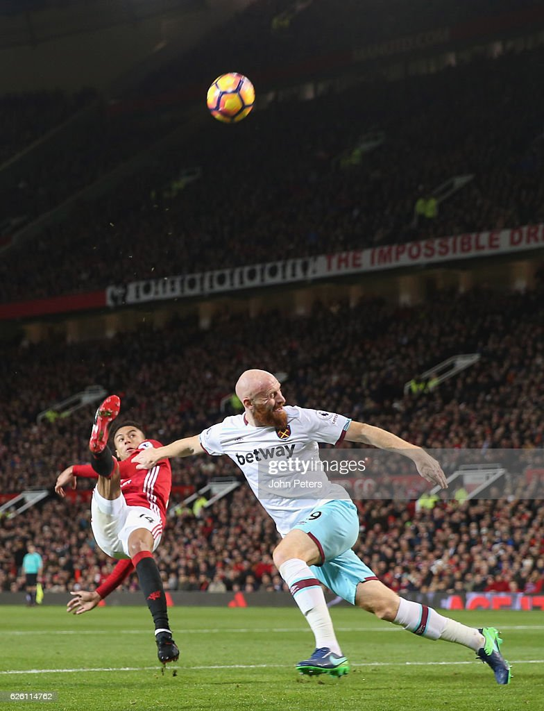 Jesse Lingard of Manchester United in action with James Collins of West Ham United during the Premier League match between Manchester United and West Ham United at Old Trafford on November 27, 2016 in Manchester, England.
