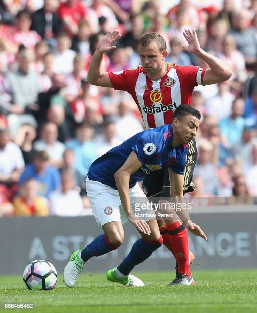 Jesse Lingard of Manchester United in action with Lee Cattermole of Sunderland during the Premier League match between Sunderland and Manchester...