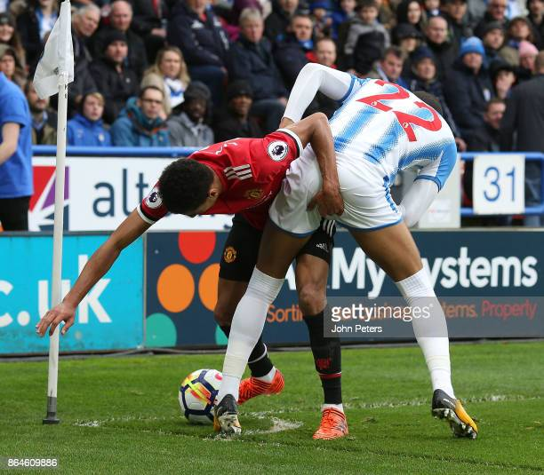 Jesse Lingard of Manchester United in action with Tom Ince of Huddersfield Town during the Premier League match between Huddersfield Town and...