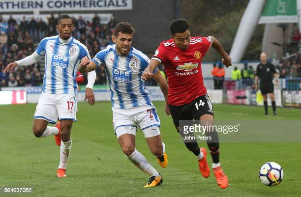 Jesse Lingard of Manchester United in action with Tommy Smith of Huddersfield Town during the Premier League match between Huddersfield Town and...