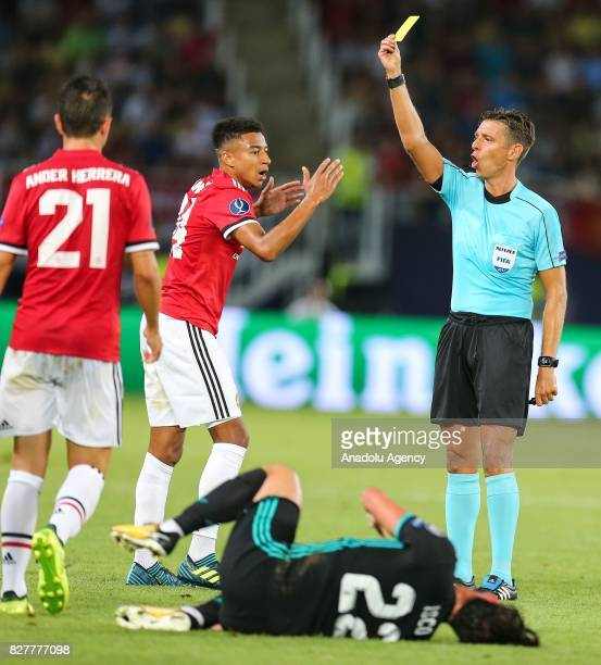 Jesse Lingard of Manchester United is being booked with yellow card during the UEFA Super Cup final between Real Madrid and Manchester United at the...