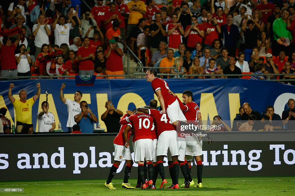 Jesse Lingard #35 of Manchester United is congratulated by his teammates for his goal against Liverpool in the Guinness International Champions Cup 2014 Final at Sun Life Stadium on August 4, 2014 in Miami Gardens, Florida. United defeated Liverpool 3-1.
