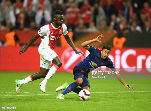 Jesse Lingard of Manchester United is tackled by Davinson Sánchez of Ajax during the UEFA Europa League Final between Ajax and Manchester United at...