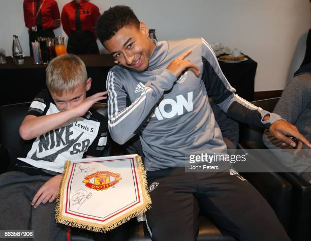 Jesse Lingard of Manchester United poses with Lewis during a MU Foundation Dream Day at Aon Training Complex on October 20 2017 in Manchester England