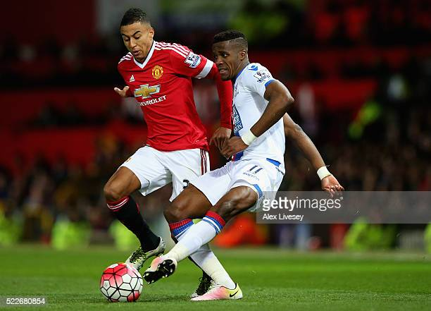 Jesse Lingard of Manchester United puts pressure on Wilfried Zaha of Crystal Palace during the Barclays Premier League match between Manchester...
