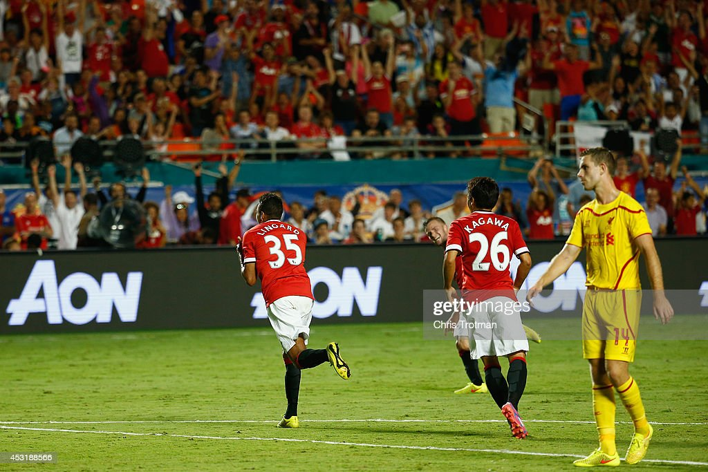 Jesse Lingard #35 of Manchester United reacts after scoring a goal as teammate Shinji Kagawa #26 of Manchester United looks on against Liverpool in the Guinness International Champions Cup 2014 Final at Sun Life Stadium on August 4, 2014 in Miami Gardens, Florida.