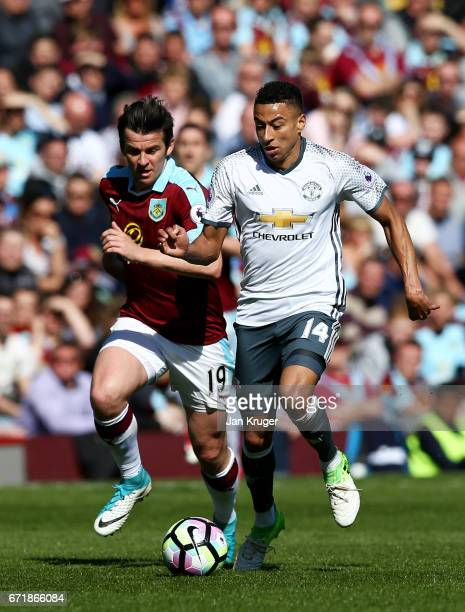 Jesse Lingard of Manchester United runs with the ball under pressure from Joey Barton of Burnley during the Premier League match between Burnley and...
