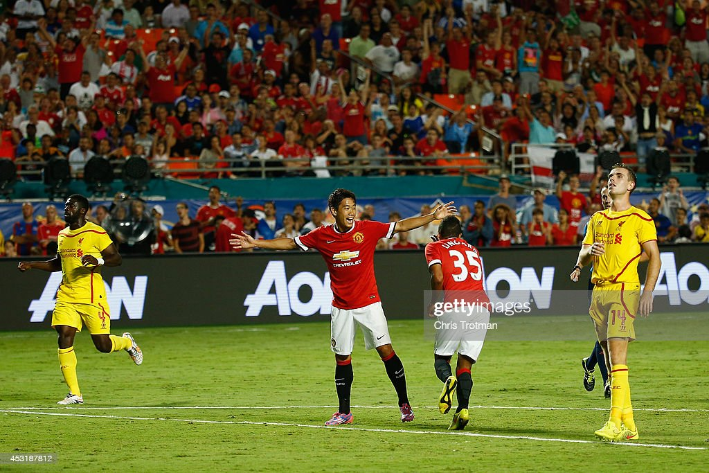 Jesse Lingard #35 of Manchester United scores a goal as teammate Shinji Kagawa #26 of Manchester United reacts against Liverpool in the Guinness International Champions Cup 2014 Final at Sun Life Stadium on August 4, 2014 in Miami Gardens, Florida.