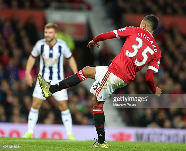 Jesse Lingard of Manchester United scores their first goal during the Barclays Premier League match between Manchester United and West Bromwich...