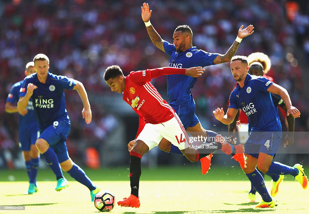Jesse Lingard of Manchester United skips past Danny Simpson of Leicester City on the way to scoring the first goal during The FA Community Shield match between Leicester City and Manchester United at Wembley Stadium on August 7, 2016 in London, England.