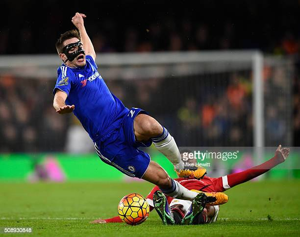 Jesse Lingard of Manchester United tackles Cesar Azpilicueta of Chelsea during the Barclays Premier League match between Chelsea and Manchester...