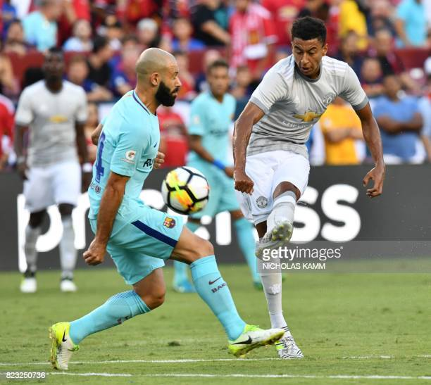 Jesse Lingard of Manchester United vies for the ball with Javier Mascherano of Barcelona during their International Champions Cup football match on...