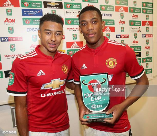 Jesse Lingard presents Anthony Martial of Manchester United with the Man of the Match award after the Carabao Cup Third Round match between...