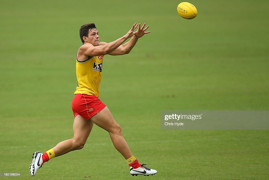 Jesse Lonergan jumps for the ball during a Gold Coast Suns AFL training session at Metricon Stadium on February 20, 2013 in Gold Coast, Australia.