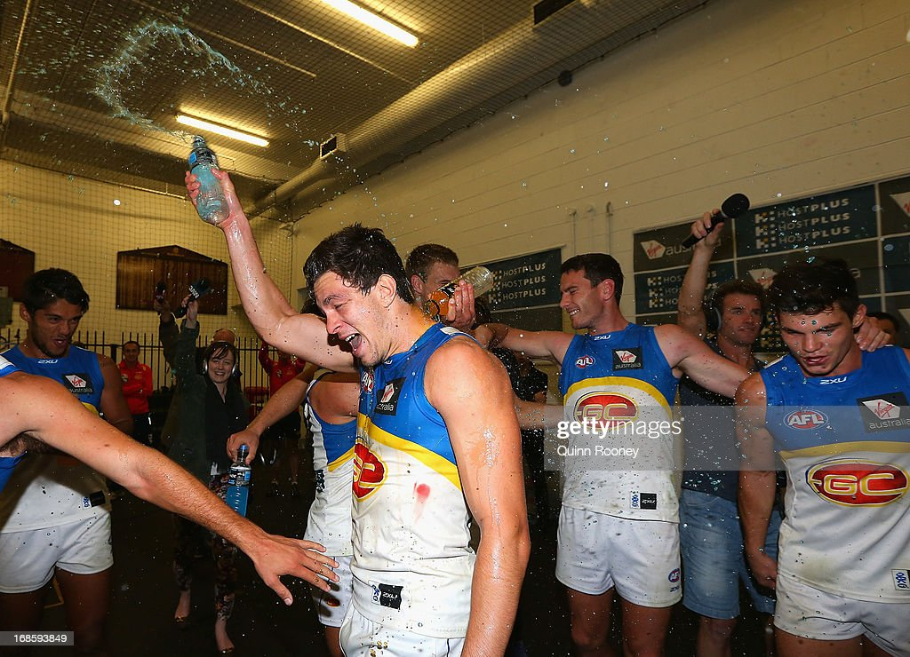 Jesse Lonergan of the Suns celebrates in the rooms after winning the round seven AFL match between the Melbourne Demons and the Gold Coast Suns at Melbourne Cricket Ground on May 12, 2013 in Melbourne, Australia.