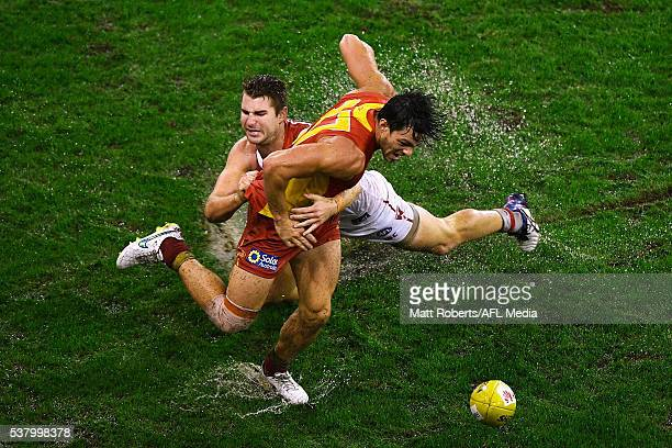 Jesse Lonergan of the Suns competes for the ball against Harrison Marsh of the Swans during the round 11 AFL match between the Gold Coast Suns and...