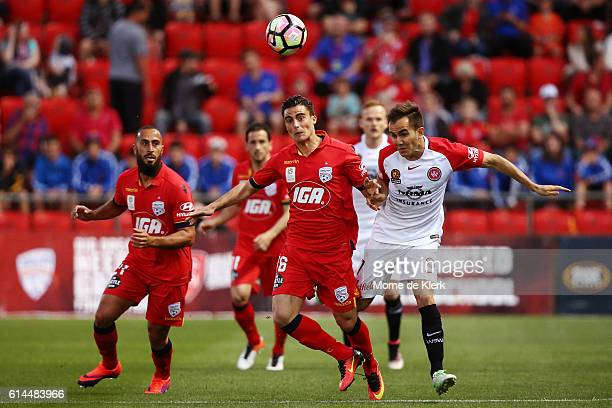 Jesse Makarounas of Adelaide United competes for the ball with Steven Lustica of the Wanderers during the round two ALeague match between Adelaide...
