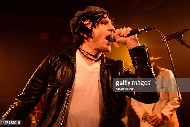 Jesse Malin and Danny Clinch perform onstage with Tangiers Blues Band during the 'Still Moving' book release party at The McKittrick Hotel on October...