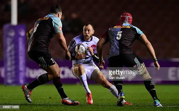 Jesse Mogg of Montpellier takes on Nick Easter of Harlequins and Sam Twomey of Harlequins during the European Rugby Challenge Cup Pool 3 match...