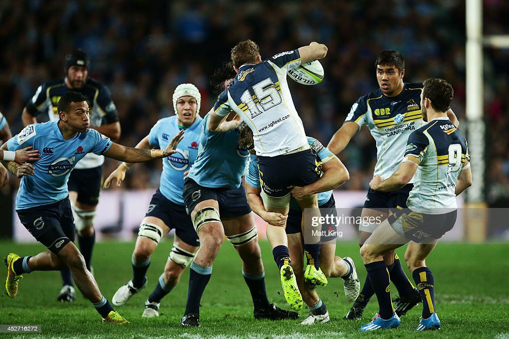 <a gi-track='captionPersonalityLinkClicked' href=/galleries/search?phrase=Jesse+Mogg&family=editorial&specificpeople=8908103 ng-click='$event.stopPropagation()'>Jesse Mogg</a> of the Brumbies is tackled heavily by Michael Hooper of the Waratahs during the Super Rugby Semi Final match between the Waratahs and the Brumbies at Allianz Stadium on July 26, 2014 in Sydney, Australia.