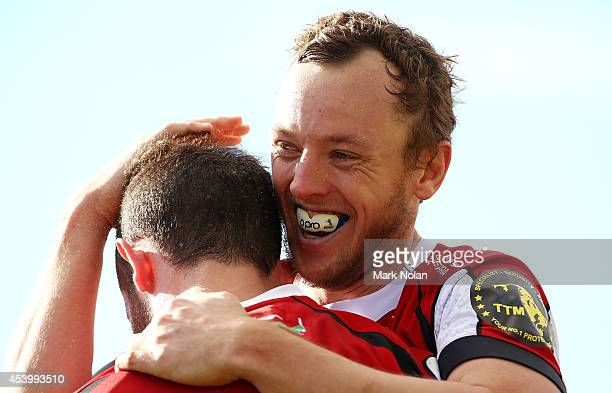 Jesse Mogg of the Vikings congratulates team mate Robbie Coleman after he scored during the round one National Rugby Championship match between the...