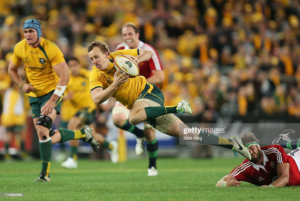 <a gi-track='captionPersonalityLinkClicked' href=/galleries/search?phrase=Jesse+Mogg&family=editorial&specificpeople=8908103 ng-click='$event.stopPropagation()'>Jesse Mogg</a> of the Wallabies is ankle tapped by <a gi-track='captionPersonalityLinkClicked' href=/galleries/search?phrase=Geoff+Parling&family=editorial&specificpeople=820816 ng-click='$event.stopPropagation()'>Geoff Parling</a> of the Lions during the International Test match between the Australian Wallabies and British & Irish Lions at ANZ Stadium on July 6, 2013 in Sydney, Australia.