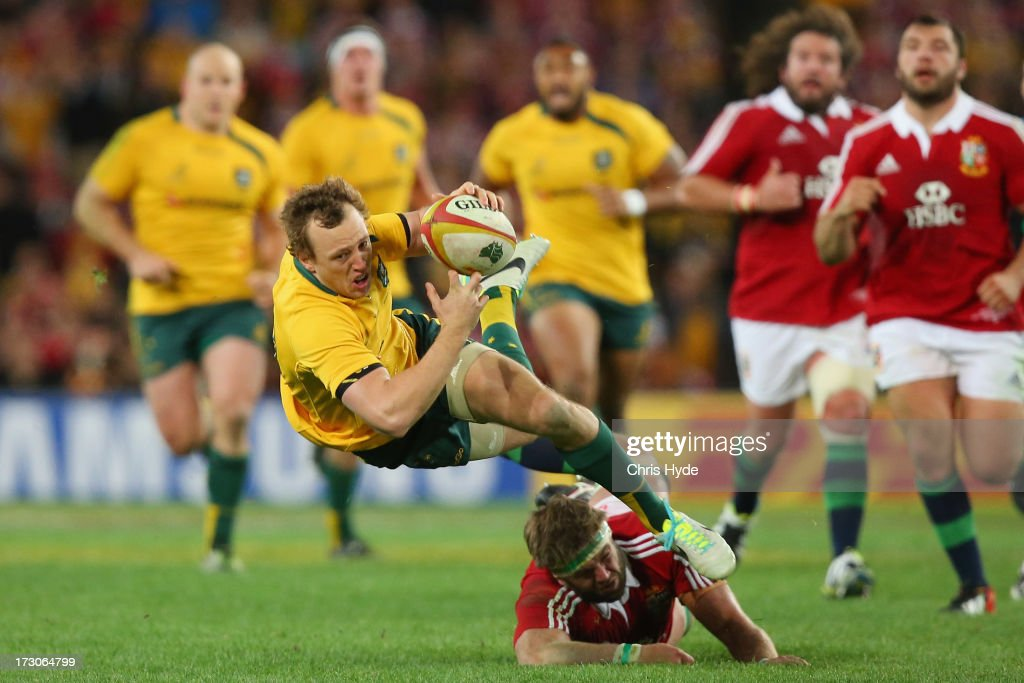 <a gi-track='captionPersonalityLinkClicked' href=/galleries/search?phrase=Jesse+Mogg&family=editorial&specificpeople=8908103 ng-click='$event.stopPropagation()'>Jesse Mogg</a> of the Wallabies is tackled by <a gi-track='captionPersonalityLinkClicked' href=/galleries/search?phrase=Geoff+Parling&family=editorial&specificpeople=820816 ng-click='$event.stopPropagation()'>Geoff Parling</a> of the British & Irish Lions during the International Test match between the Australian Wallabies and British & Irish Lions at ANZ Stadium on July 6, 2013 in Sydney, Australia.