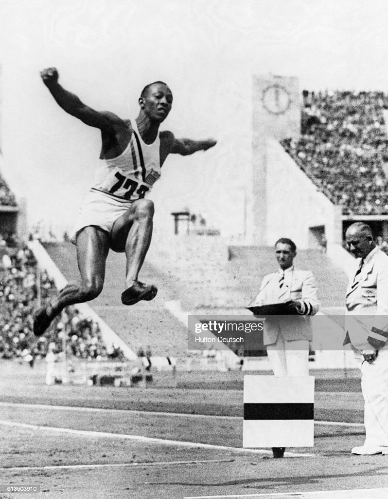 Jesse Owens of the United States leaps to gold and sets a world record in the running board jump, at the 1936 Olympic Games.