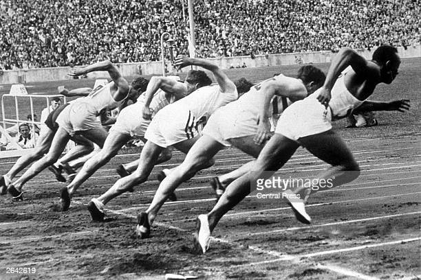 Jesse Owens of the USA far right at the start of a race at the 1936 Olympic Games in Berlin