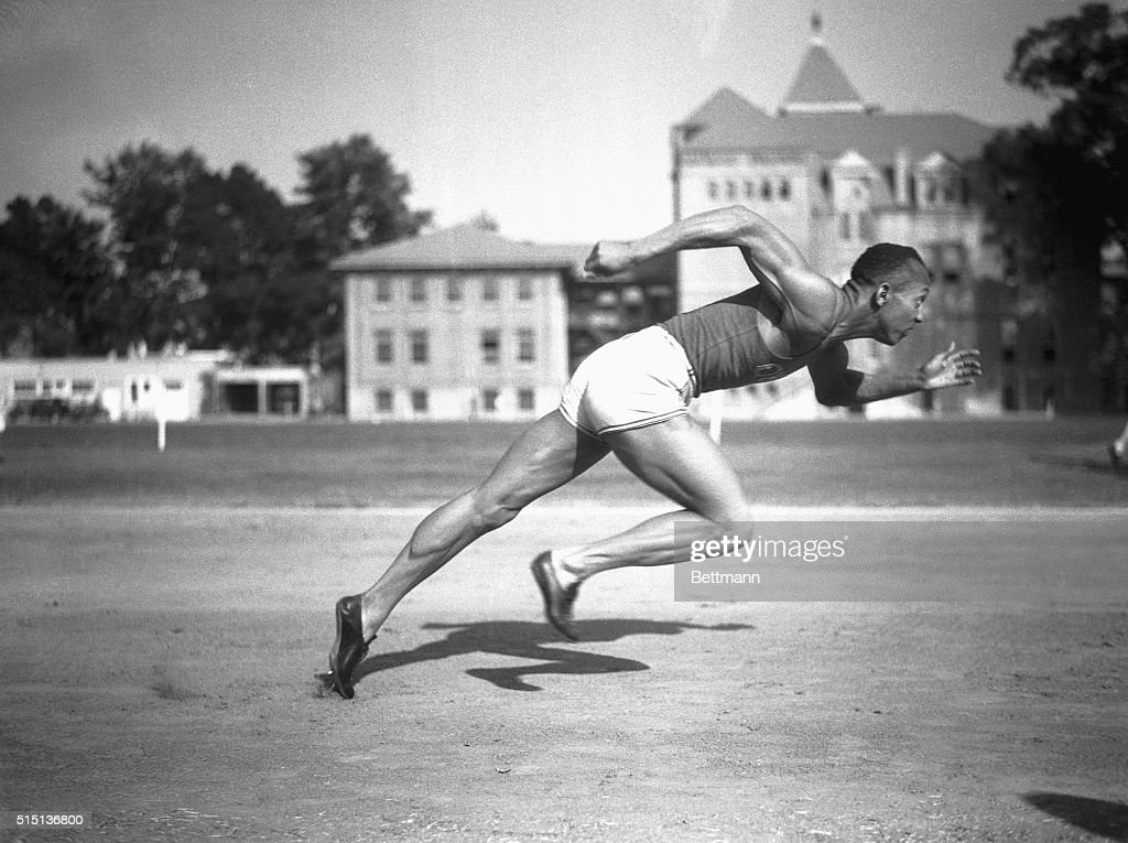 Jesse Owens, Ohio State's sensational athlete, is shown in the midst of running a sprint.