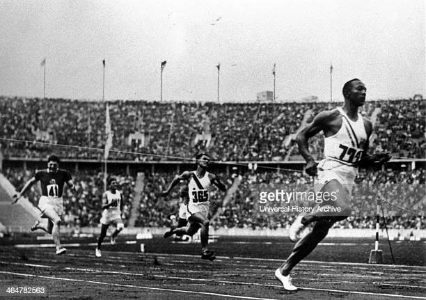 Jesse Owens running at 1936 Olympics in Berlin