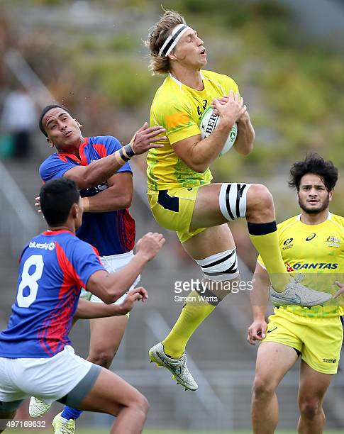 Jesse Parahi of Australia takes a high ball during the World Sevens Oceania Olympic Qualification match between Australia and American Samoa on...