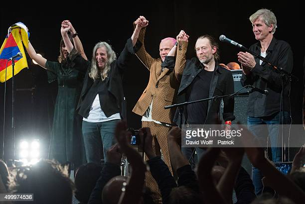 Jesse Paris Smith Patti Smith Thom Yorke Flea and Tony Shanahan perform during Pathway to Paris at Le Trianon on December 4 2015 in Paris France